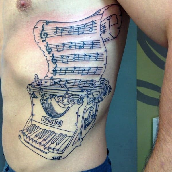 Male With Typewriter Musical Note Piano Themed Rib Cage Side Tattoo