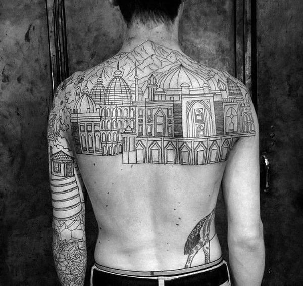 Male With Upper Bakc Tattoo Of Buildings