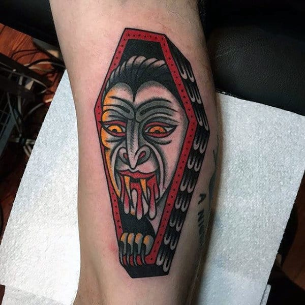 Male With Vampire Bites Tattoo And Casket On Forearm