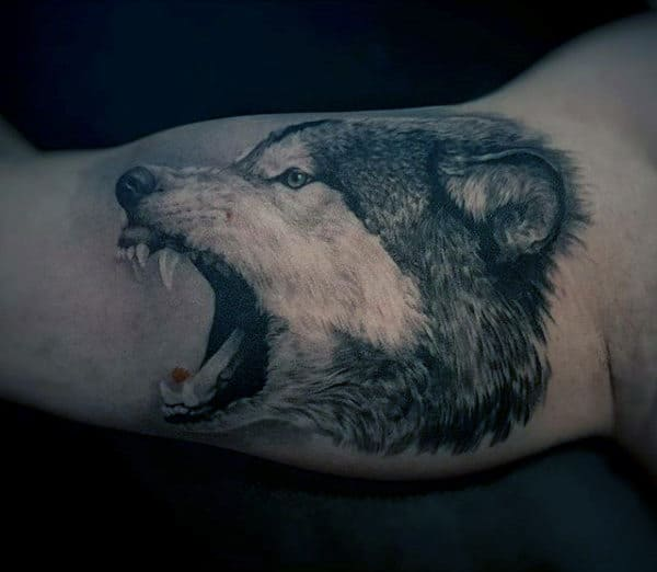 Male With Wolf Bicep Animal Tattoo