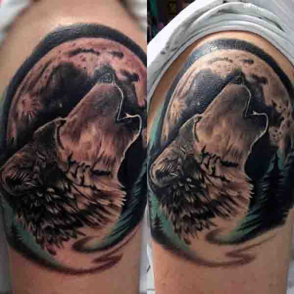 Male Wolf Howling At Moon Tattoo On Upper Arm