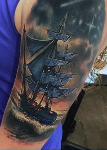 Male With Tattoos Of Ships On Upper Arm