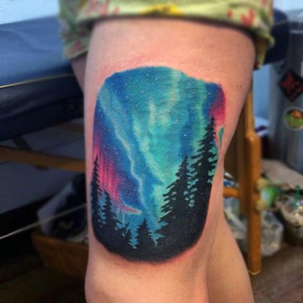 Males Creative Northern Lights With Treeline Upper Leg Tattoo