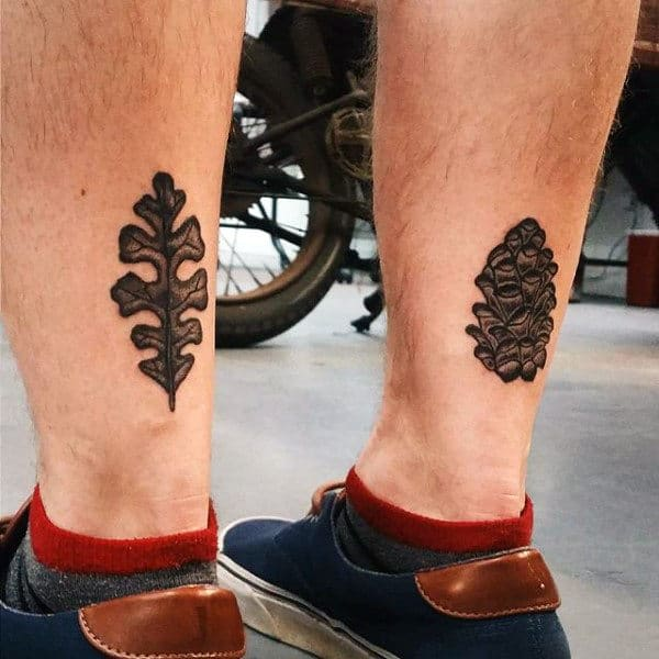 Males Modern Leaf And Acorn Tattoo On Ankles
