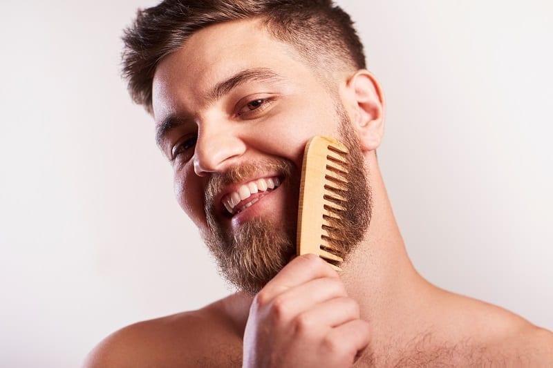 man-brushing-beard