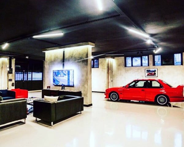 Man Cave Dream Garage Design With Black Ceiling And Lounge Area