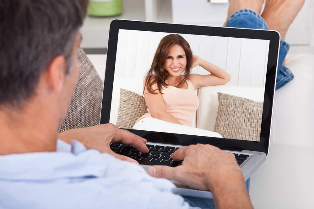 man chatting woman using laptop