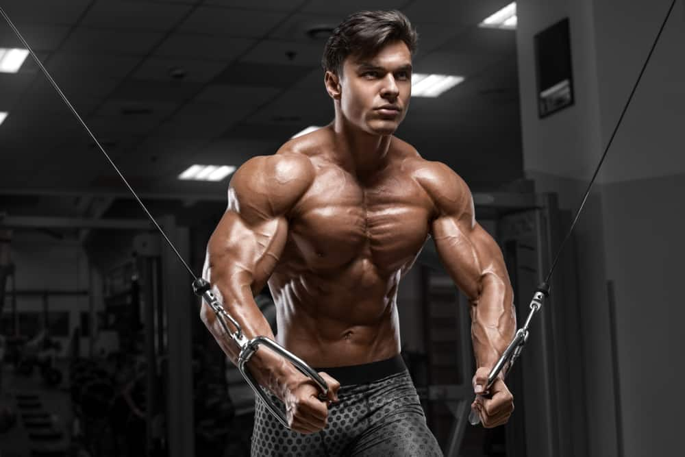 man workout in gym doing cable crossover exercise for chest