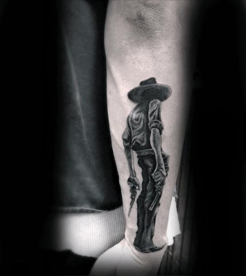 Man Holding Gun Cowboy Blackwork Tattoo On Forearm