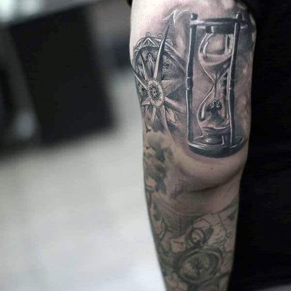 Man Inside Hourglass Tattoo Design On Back Of Arm