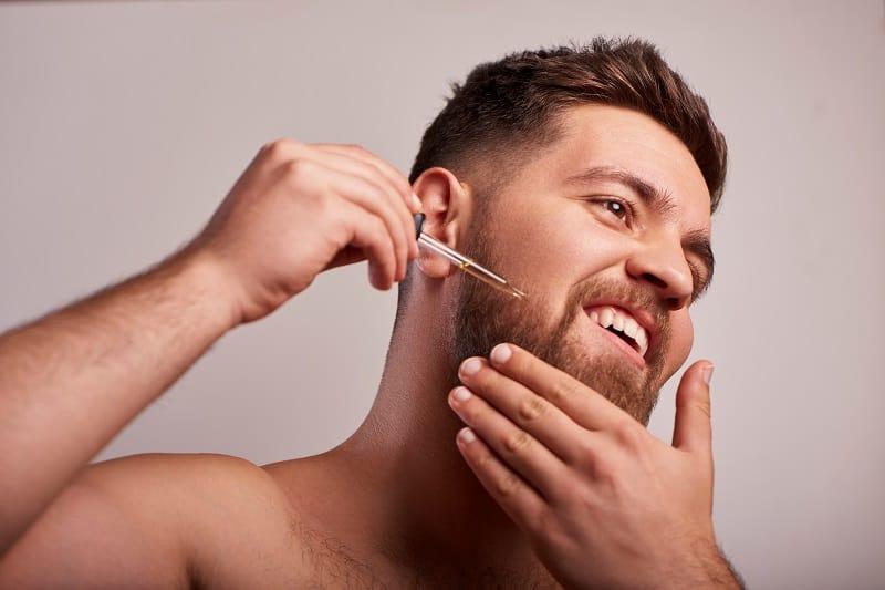 man-oiling-beard