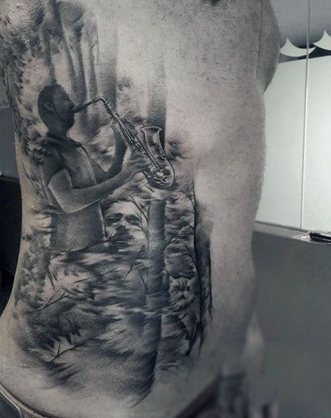 Man Playing Music Tattoo On Torso For Men