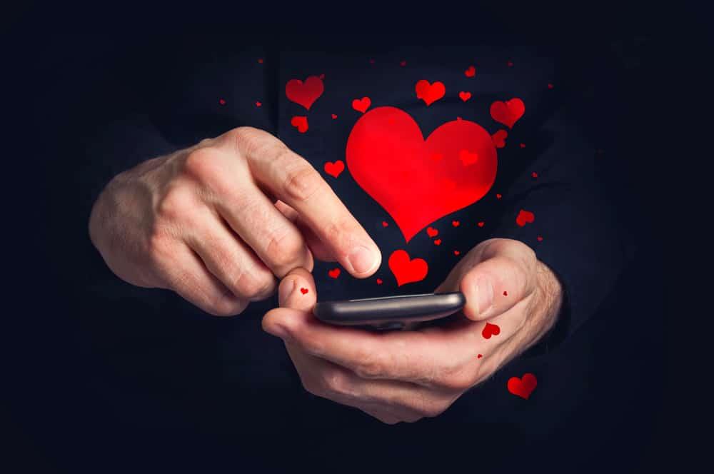 man typing mobile phone
