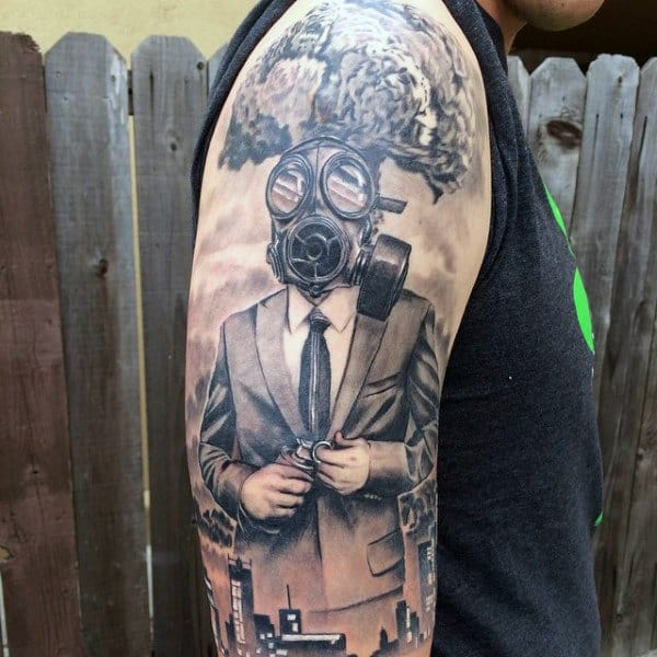 Man Wearing A Suit And Gas Mask Tattoo On Arm With Explosion