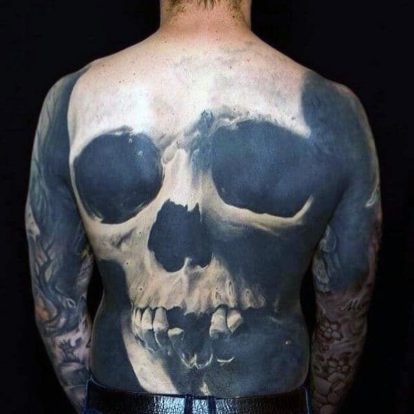 Man With 3D Hollow Dark Eye Skull Tattoo Full Back