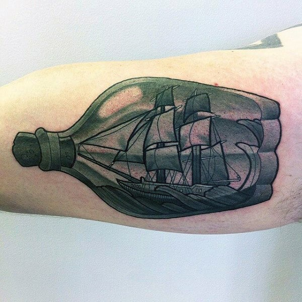 Man With 3d Bicep Ship In A Bottle Tattoo