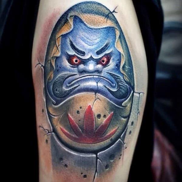 Man With 3d Daruma Doll Blue Ink Tattoo On Arm
