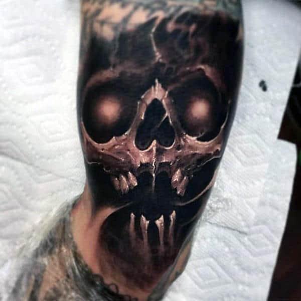 Man With 3d Inner Arm Skull Tattoo