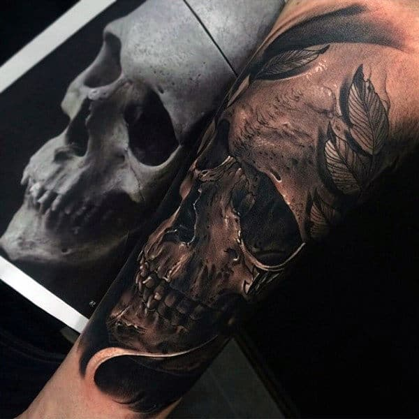Man With 3d Inner Forearm Realistic Skull Design Tattoo
