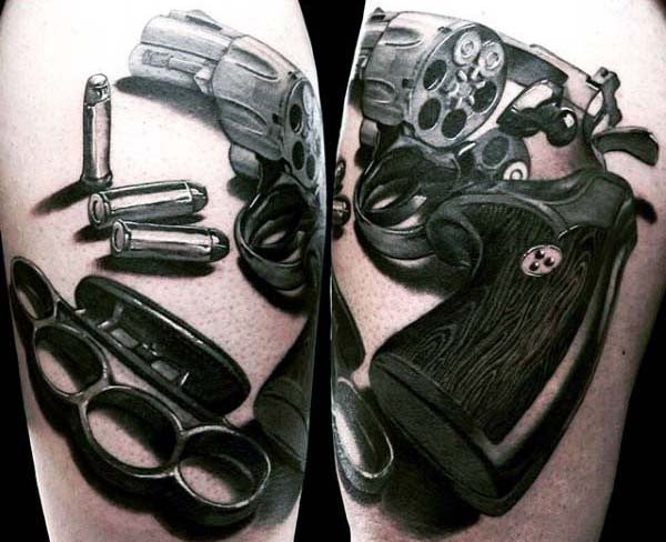 Man With 3d Revolver Tattoo And Bullet Design In Black Ink