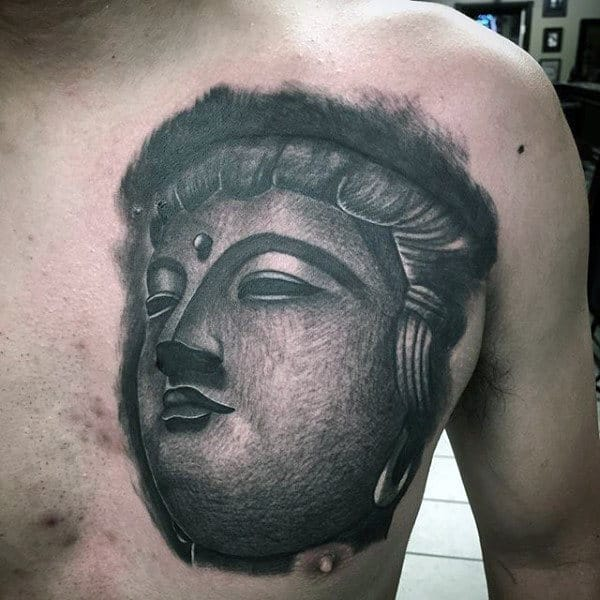 Man With Buddha Face Tattoo On Chest