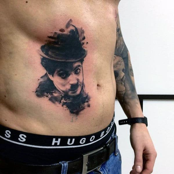 Man With A Hat Watercolor Tattoo On Torso For Guys