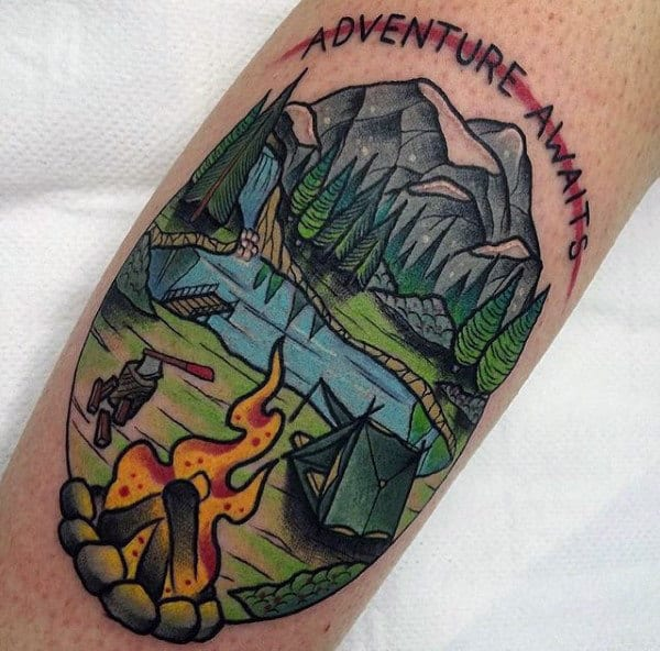 Man With Adventure Awaits Camping Tattoo On Forearm