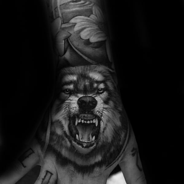 Man With Amazing Realistic 3d Tattoo Of Wolf On Hand