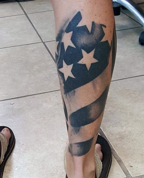 Man With American Flag Tattoo On Leg Calf
