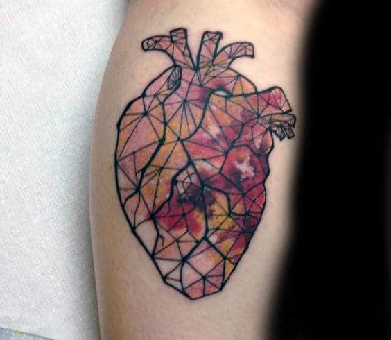 Man With Anatomical Heart Stained Glass Tattoo On Forearm