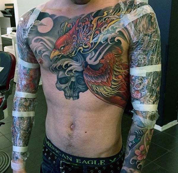 Man With Awesome Sleeve Tattoos And Upper Chest Ink