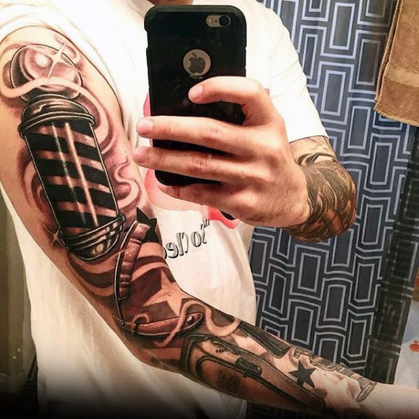 Man With Awesome Straight Razor Tattoo On Full Sleeves