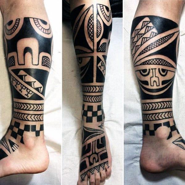 Man With Awesome Tribal Owl Leg Sleeve Tattoo