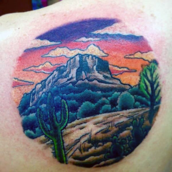 Man With Back Of Shoulder Cactus Desert Road Tattoo Design