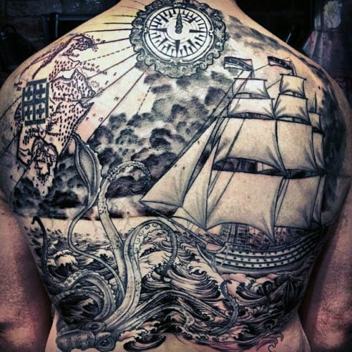 Man With Back Tattoo Of Squid In Ocean Sea And Sailing Ship In Black Ink