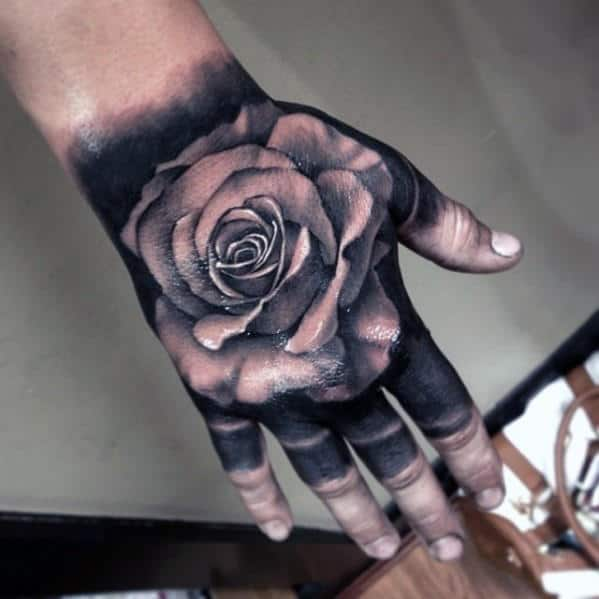 Man With Badass Black Ink Background And White Rose Hand Tattoo