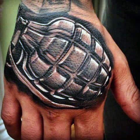 Man With Badass Hand Grenade Tattoo On Hands