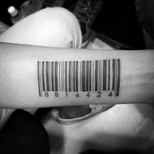 Man With Barcode Tattoo On Inner Forearm