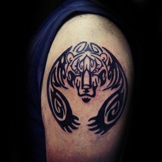 Man With Bear Claw Upper Arm Tattoo Tribal Designs