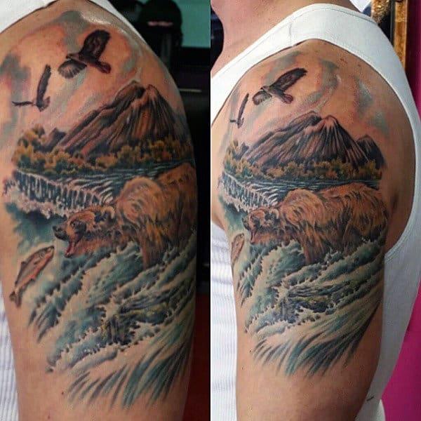 Man With Bear Hunting In River Tattoo On Upper Arm