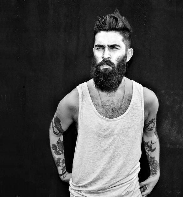Man With Beard And Cool Undercut Hairstyle Medium Length