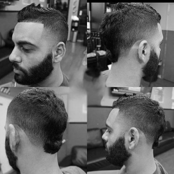 Man With Beard And Faux Hawk Fade Haircut