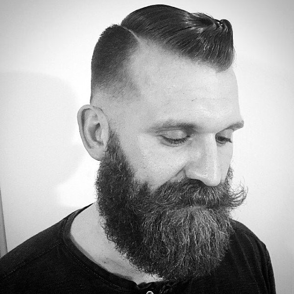 Man With Beard And Skin Fade Comb Over Haircut