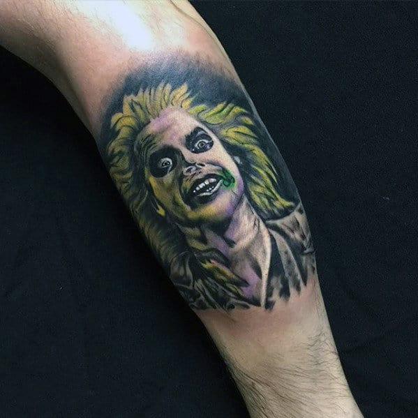 Man With Beetlejuice Leg Calf Tattoo