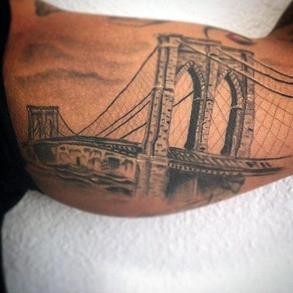 Man With Bicep Inner Arm Brooklyn Bridge Tattoo