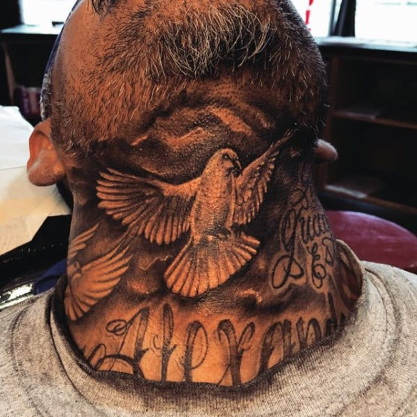 Man With Black Dove Tattoo On Neck