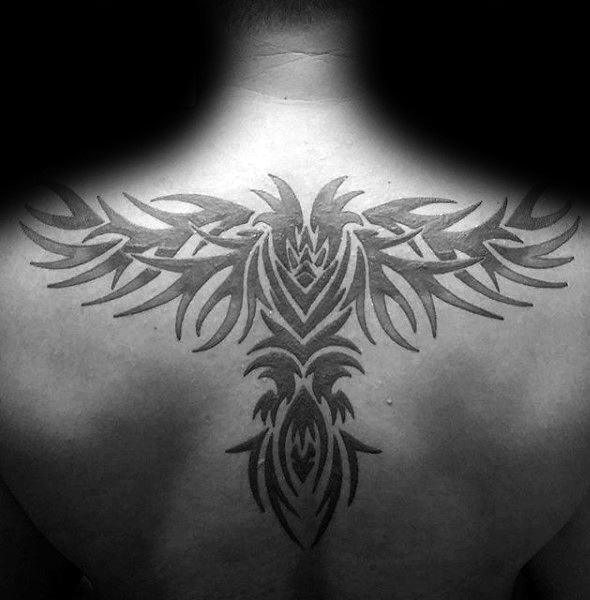 Man With Black Ink Back Tribal Eagle Tattoo