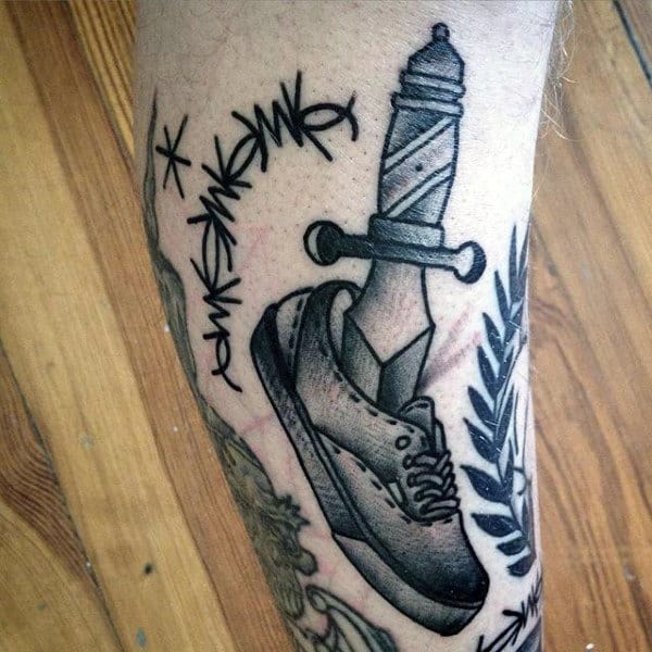 Man With Black Ink Barbed Wire Old School Tattoo On Leg
