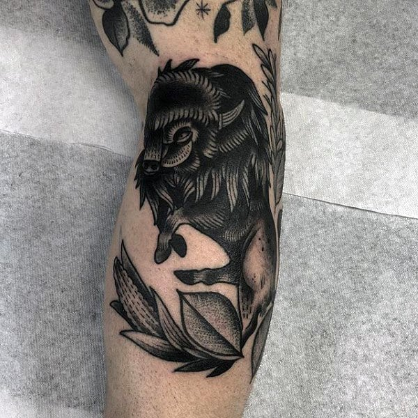 Man With Black Ink Bison Arm Tattoo