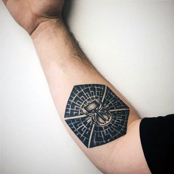 Man With Black Ink Pattern Hammer Tattoon On Inner Forearm